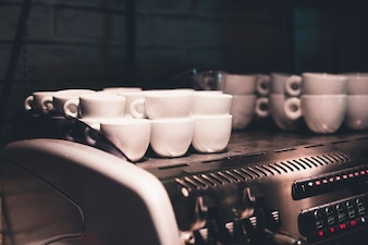 Ceramic cups on coffee machine