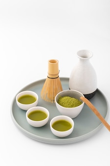 Ceramic cups with matcha tea on a tray
