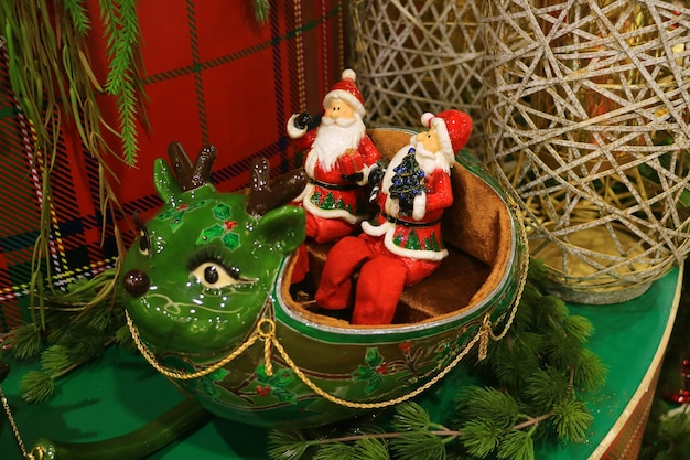 Ceramic dolls of santa claus and reindeer for christmas decoration