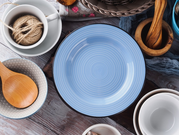 Ceramic and enamel crockery on wooden