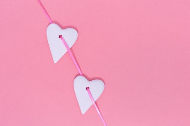 Ceramic hearts hangs on ribbon.