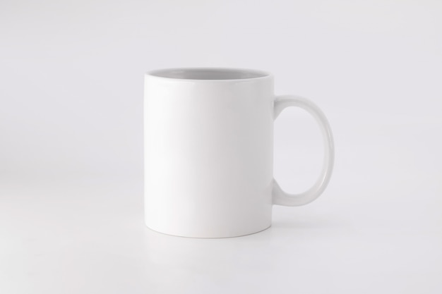 Ceramic mug on white background. blank drink cup for your design.