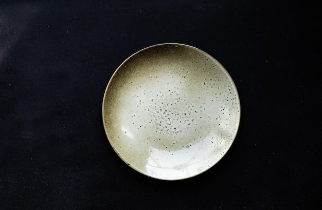 Ceramic plate on dark background