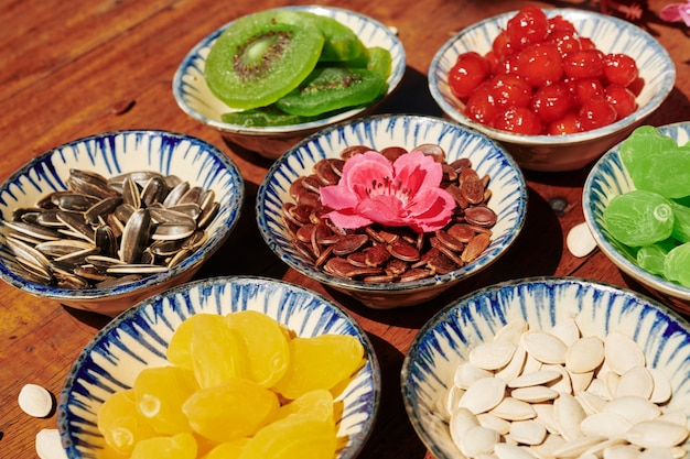 Ceramic plates with dried fruits and seeds