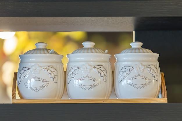 Ceramic tableware on the wooden dark gray shelf