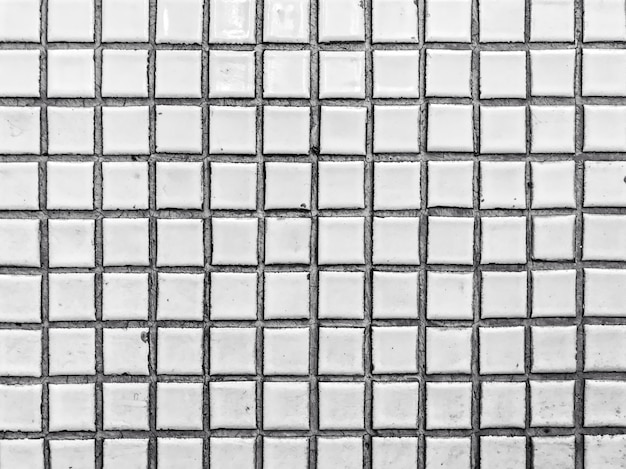 セラミックタイル。抽象的な背景の黒と白。ミニマリズムのアーキテクチャ。モダンなパターンの建物の詳細。