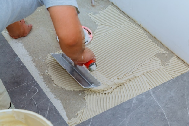 Ceramic tiles and tools for tiler. floor tiles installation. home improvement, renovation