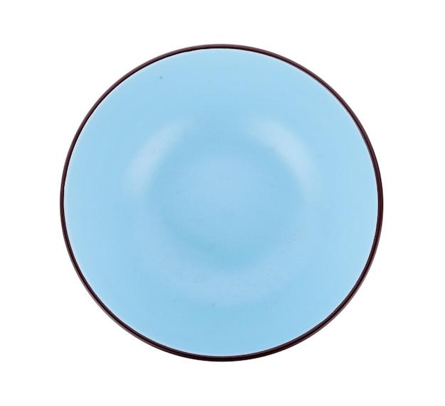 白い表面に分離されたセラミックボウル