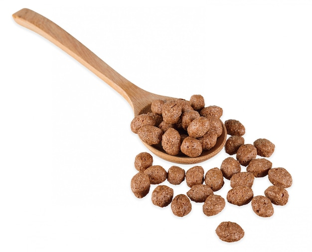 Cereal ball with wooden spoon isolated