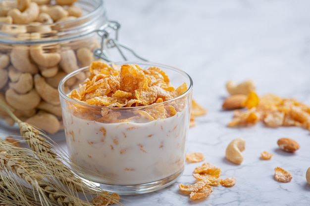 Cereal in bowl and milk on marble background