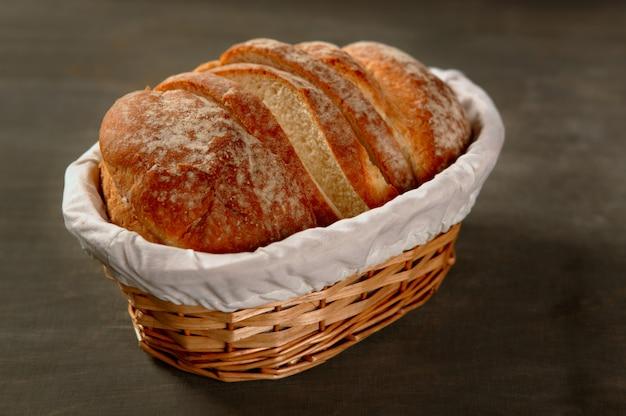 Cereal bread loaf slices over dark wood