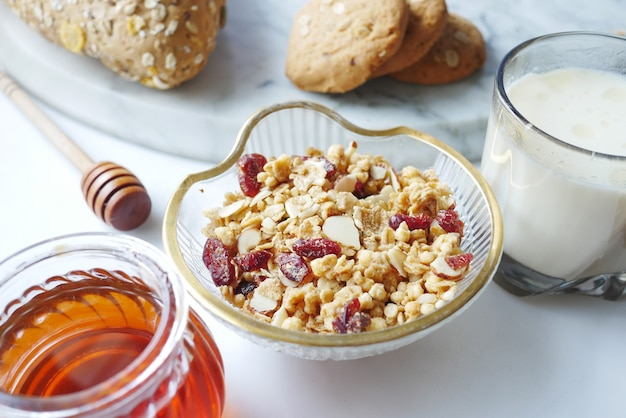 Cereal breakfast in bowl bread and honey on white background