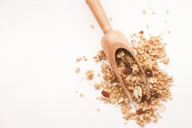 Cereal breakfast in wooden spoon on white background