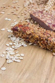 Cereal energy granola bars on dark wooden surface. healthy diet vegetarian food top view. copy space