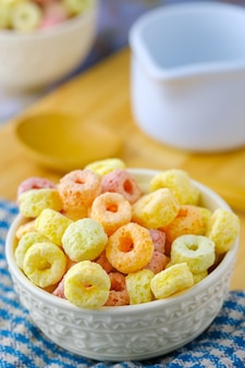 Cereal flakes in white bowl with copy space,breakfast concept.food with delicious fruity taste and fruity colours