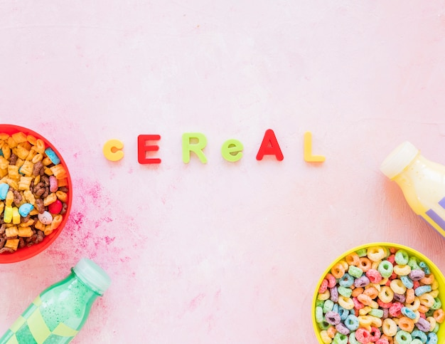 Cereal inscription with bowls on pink table