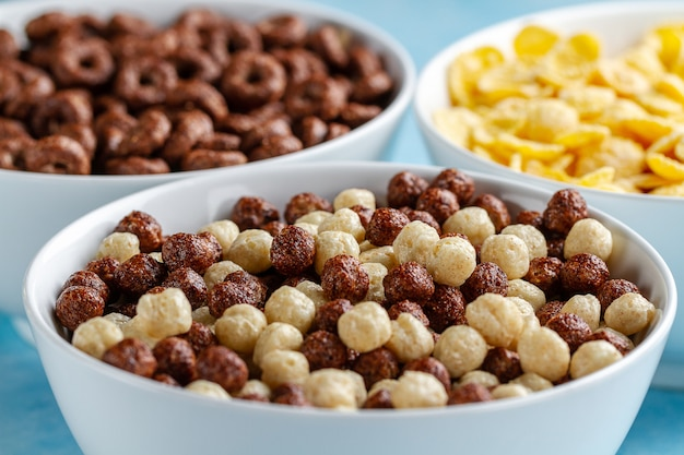 Cereals and dry breakfast of chocolate balls, rings and corn flakes