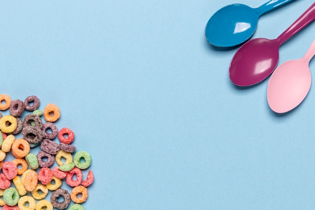 Cereals and spoons with copy space background
