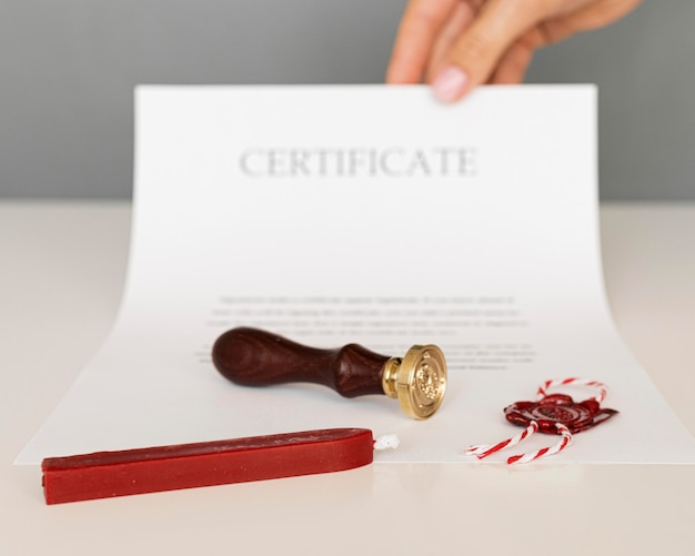 Certificate with wax seal and candle