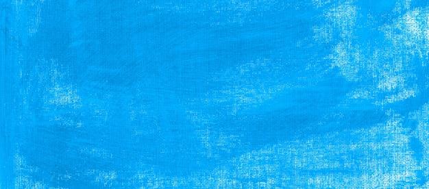 질감이 있는 캔버스 추상 배경에 칠해진 세룰리언 짙은 파란색 아크릴 유체 색상 최소 청소