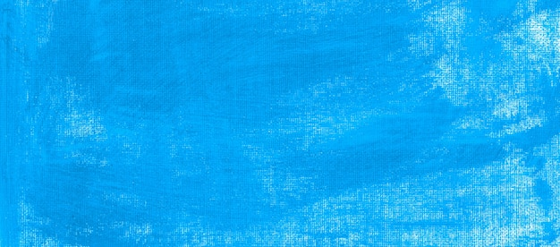 Cerulean dark blue acrylic fluid color minimal clean painted on textured canvas abstract background