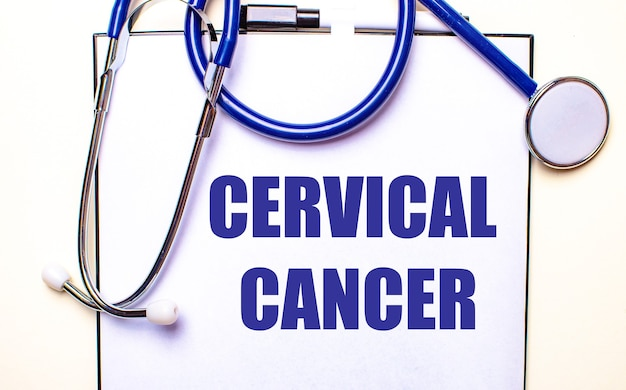 Cervical cancer is written on a white sheet near the stethoscope