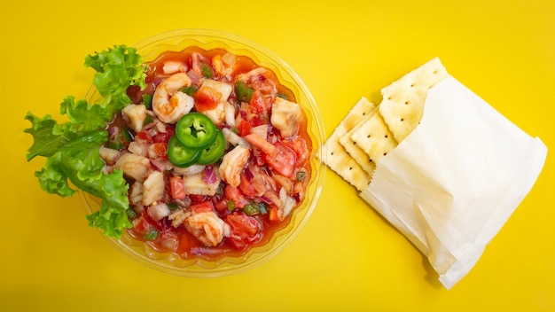 Ceviche with yellow background