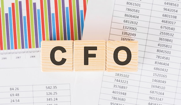 Cfo word written on wood block. faqs text on table, concept.