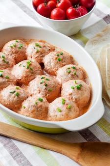 Chacken meatballs baked in creamy tomato sauce