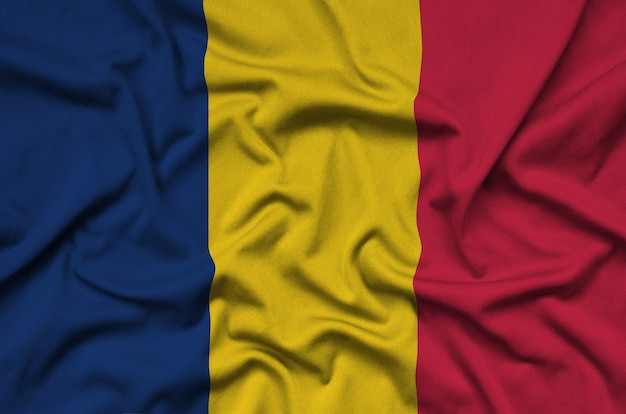 Chad flag  is depicted on a sports cloth fabric with many folds.