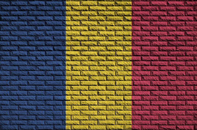 Chad flag is painted onto an old brick wall