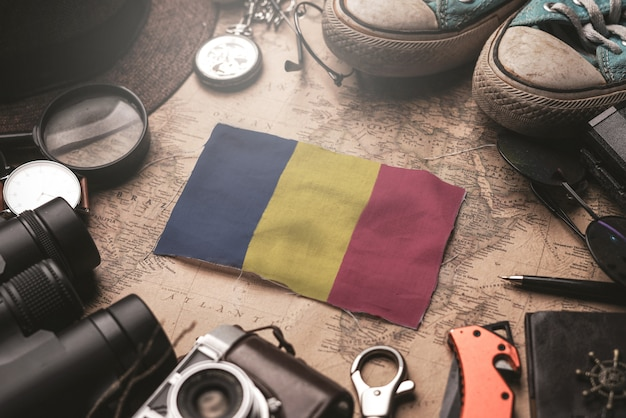 Chad flag between traveler's accessories on old vintage map. tourist destination concept.