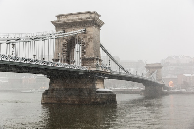 Chain bridge in budapest under the snow