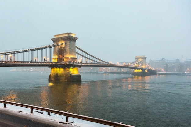 Chain bridge in budapest at twilight with snow