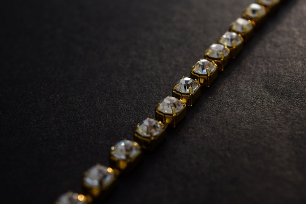 A chain of diamonds in gold