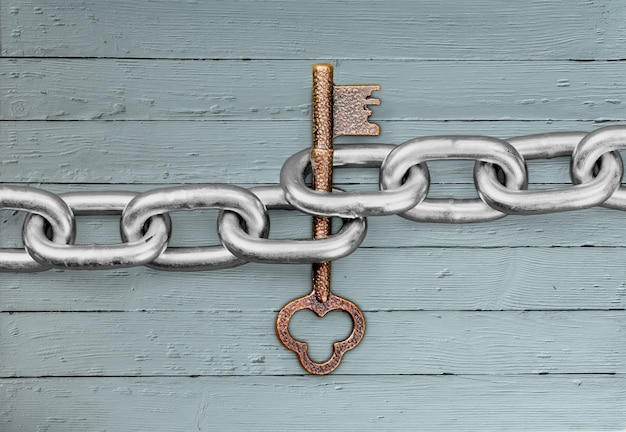 Chain and old key on  background.