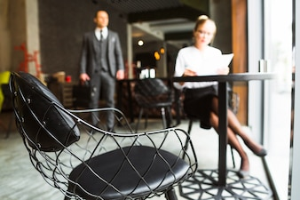 Chair in front of businesswoman sitting in caf�