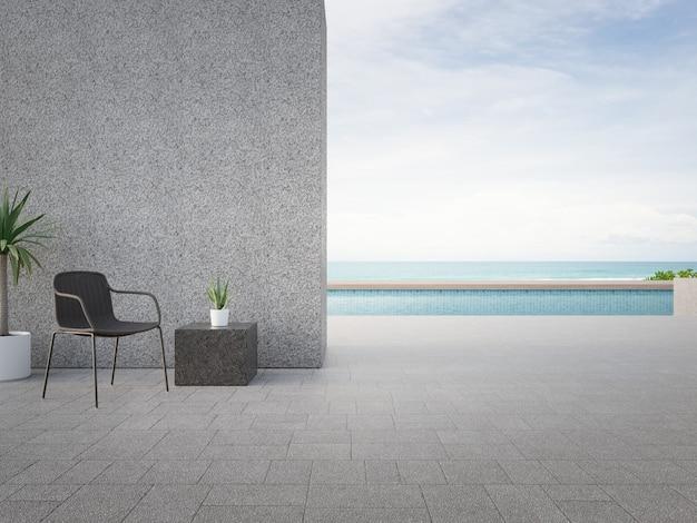 Стул на террасе возле бассейна в современном пляжном домике или роскошной вилле