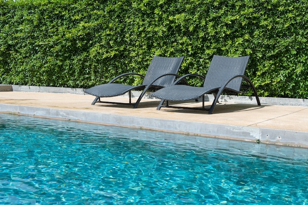 Chair on swimming pool