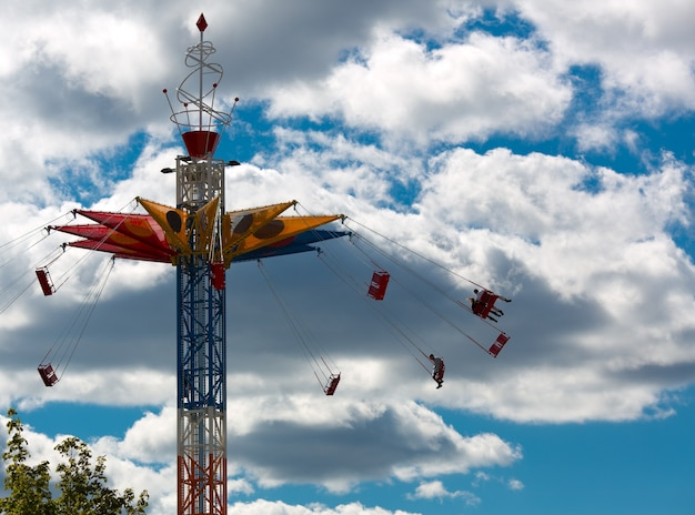 Chairoplane in sky