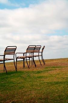 Chairs on grassland