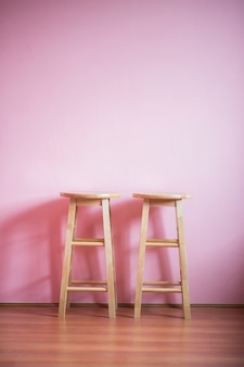 Chairs on pink wall