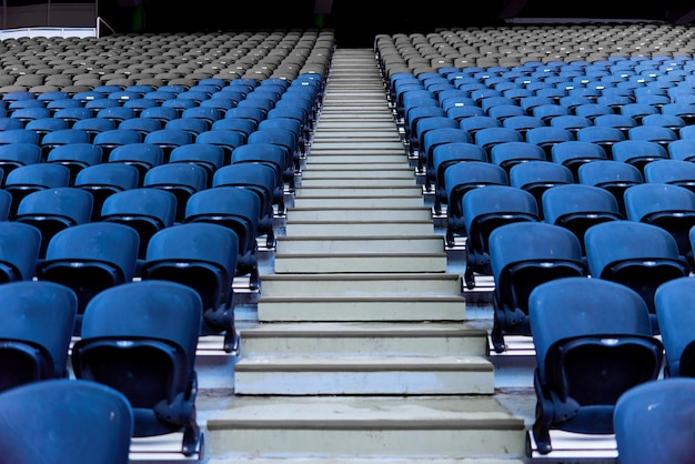 Chairs in the stadium for spectators standing in a row