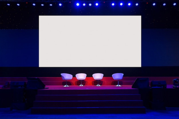 Chairs on stage in conference hall  at business event or seminar meeting, business and education concept
