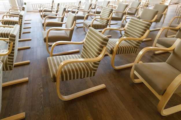 Chairs stand in rows in the hall. high quality photo