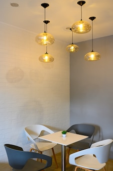Chairs table and ceiling lamp in restaurant
