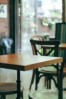Chairs and wooden tables in indoor industrial and modern style canteen - empty with nobody using the area