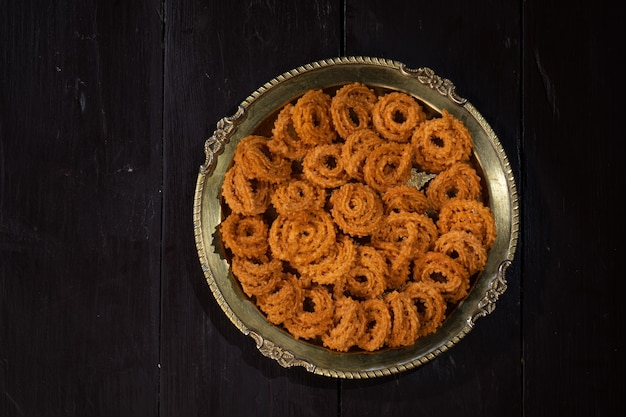 Chakali or murukku snack is made on indian diwali, holi festival food
