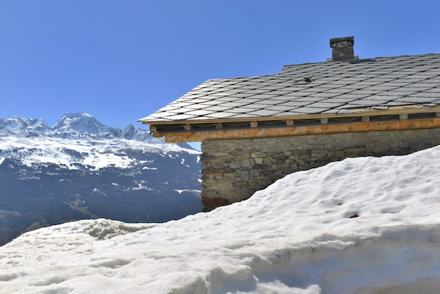 Chalet in hight snowy mountain