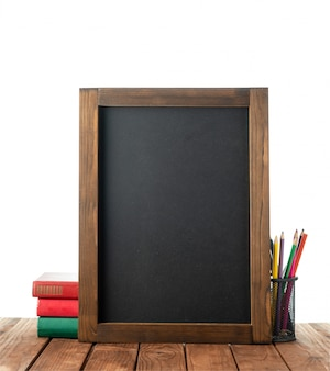 Chalk board with books and colored pencils